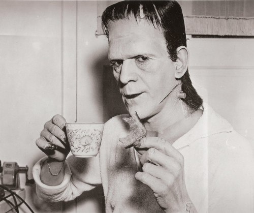 Boris Karloff on set taking a tea and toast break